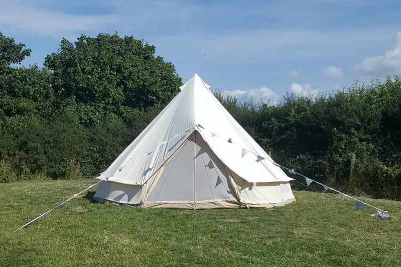 Bell tent in a field daylight